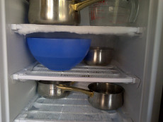 Defrosting the freezer quickly. Hot water.